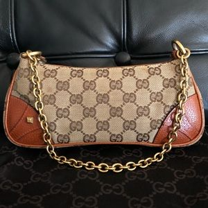 Authentic Gucci Clutch with Chain